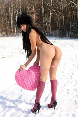 Naked Japanese model posing in the snow